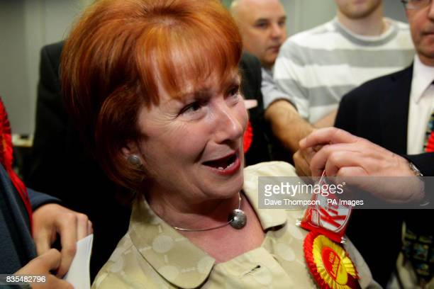 A member of the BNP offers a KitKat in front of MP Hazel Blears after Labour candidate Matt Mold won the Irwell Riverside byelection