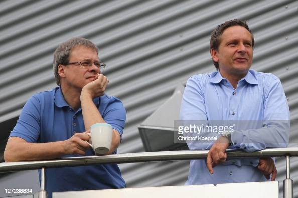 Member of the board Peter Peters and manager Horst Heldt attend the FC Schalke training session at the training ground at Veltins Arena on September...