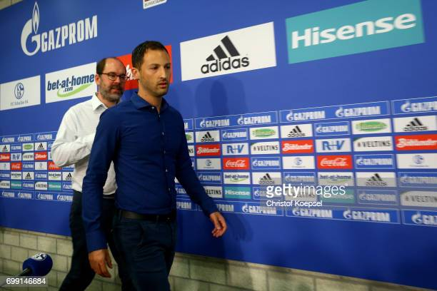 Member of the board xel Schuster and head coach Domenico Tedesco of Schalke are seen during the presentation of new head coach Domenico Tedesco at...