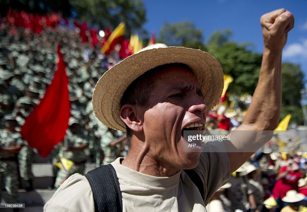 A member of the Bolivarian militias takes part in a military parade during a meeting in Caracas on January 10, 2013. With Chavez ailing and absent, Venezuela's leftist government launches a new presidential term with a display of popular support on the day he was to be inaugurated. The Supreme Court cleared the cancer-stricken president to indefinitely postpone his re-inauguration and said his existing administration could remain in office until he is well enough to take the oath. AFP PHOTO/Raul ARBOLEDA