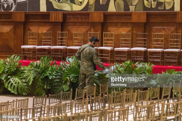 A member of the bomb squad unit checks the ceremonial room before the inauguration of LeninMoreno Ecuador's presidentelect outside the National...