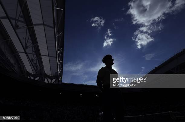 A member of the British armed forces stands on duty by the side of the court during a break in play between Switzerland's Stan Wawrinka and Russia's...
