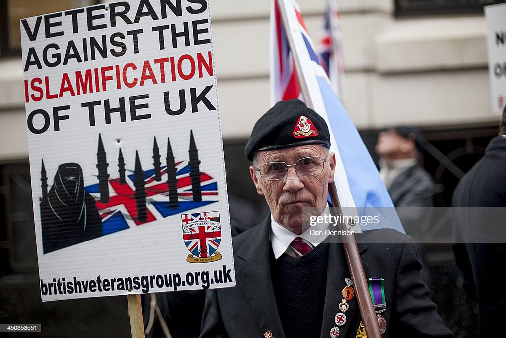 A member of the British Veterans Group takes part in a protest at Old Bailey on November 18, 2013 in London, England. The protesters, who timed their march to coincide with the start of the trial for the murder of Fusilier Lee Rigby, are calling for the restoration of Capital Punishment in the UK.