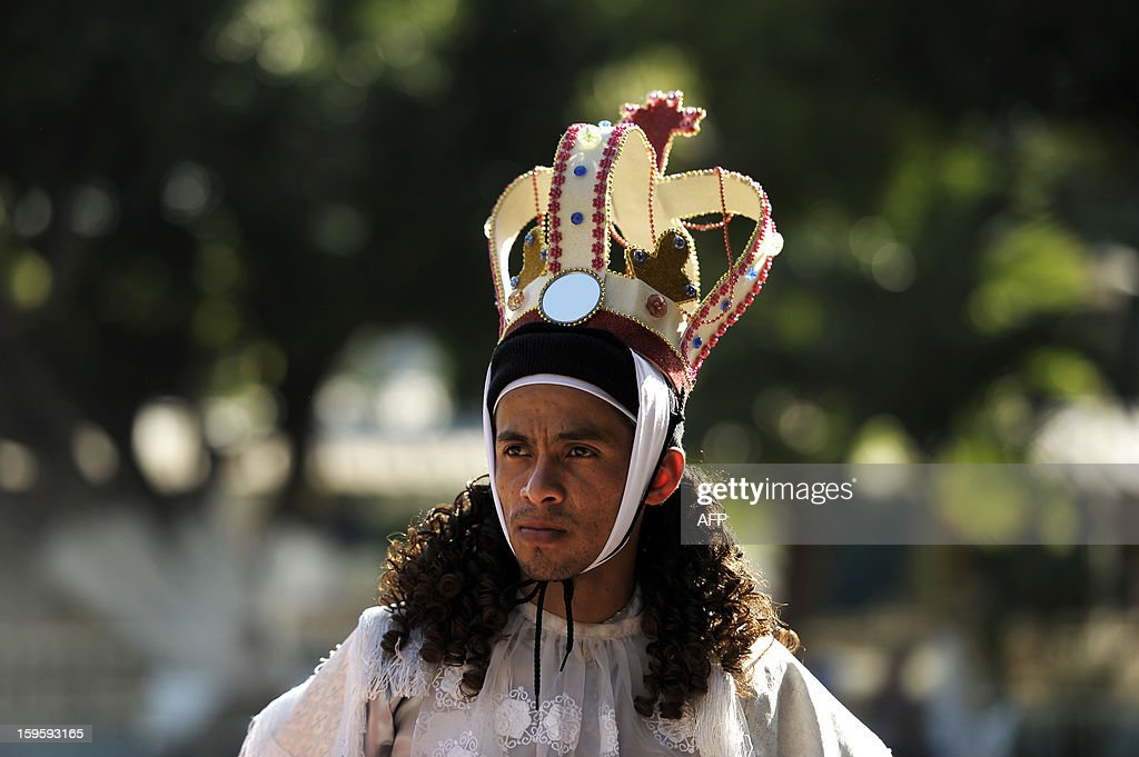 A member of the brotherhood of Saint Sebatian Matyr waits to participate in the dance of The Moors and Christians in the town of Apastepeque, 50 kms east from San Salvador, El Salvador on January 16, 2013. The members of the Saint Sebastian brotherhood dance in the honor of the co-patron saint of Apatepeque. The Moors and Christians dance tells the adventures of the crusadaders and is celebrated from more than 300 years ago. AFP PHOTO/ Jose CABEZAS