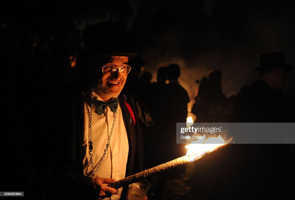 A member of the brotherhood of the ''Burial of the Sardine'' holds a torch during the Burial of the Sardine procession on February 10, 2016 in Madrid, Spain. The Sardine procession is a centuries-old Spanish tradition made famous by a painting by Spanish artist Francisco de Goya called 'El Entierro de La Sardina'. The mourners hold a mock funeral procession mourning the end of Carnival through the heart of old 'Castizo' Madrid visiting and enjoying the wines and tapas of local taverns.