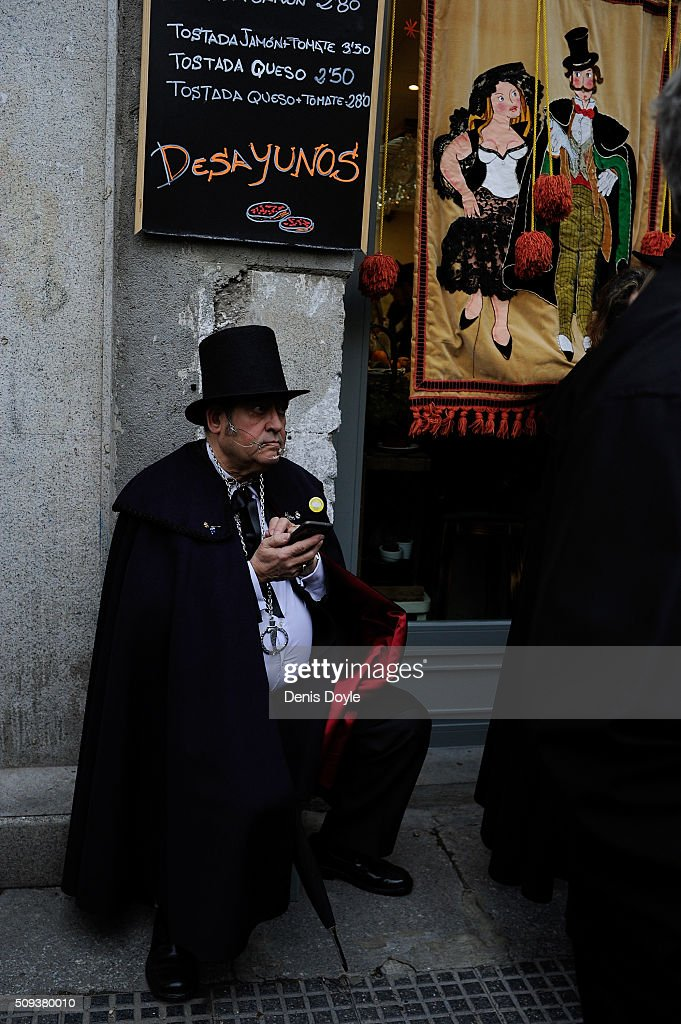 A member of the Brotherhood of the ''Burial of the Sardine'' takes a rest during the Burial of the Sardine procession on February 10, 2016 in Madrid, Spain. The Sardine procession is a centuries-old Spanish tradition made famous by a painting by Spanish artist Francisco de Goya called 'El Entierro de La Sardina'. The mourners hold a mock funeral procession mourning the end of Carnival through the heart of old 'Castizo' Madrid visiting and enjoying the wines and tapas of local taverns.
