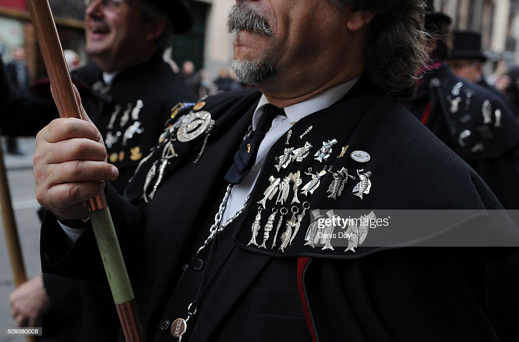 A member of the Brotherhood of the ''Burial of the Sardine'' wears pins depicting sardines during the Burial of the Sardine procession on February 10, 2016 in Madrid, Spain. The Sardine procession is a centuries-old Spanish tradition made famous by a painting by Spanish artist Francisco de Goya called 'El Entierro de La Sardina'. The mourners hold a mock funeral procession mourning the end of Carnival through the heart of old 'Castizo' Madrid visiting and enjoying the wines and tapas of local taverns.