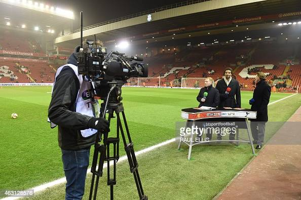 A member of the BT Sport broadcasting crew films pundits former footballers Paul Scholes David James and Steve McManaman as they prepare to do their...