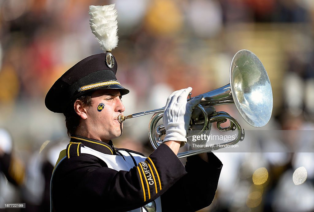 A member of the California Golden Bears marching band a trumpet player performs prior to the start of an NCAA Football game against the USC Trojans at California Memorial Stadium on November 9, 2013 in Berkeley, California.