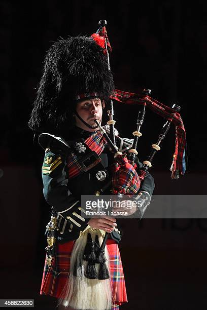 A member of the Canadian Army plays a bagpipe during the opening ceremony of the NHL game between the Montreal Canadiens and the Winnipeg Jets on...