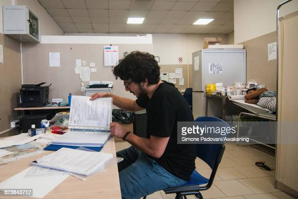 A member of the CARA Hub medical staff checks the data of an asylum seeker on July 27 2017 in Bologna Italy In an effort to address the overcrowding...