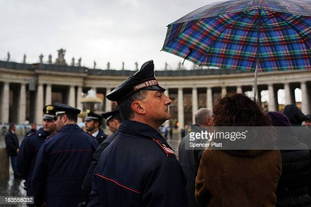 A member of the Carabinieri stands in St Peter's Square on March 12 2013 in Vatican City Vatican Pope Benedict XVI's successor is being chosen by the...