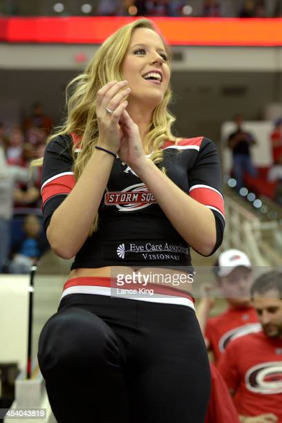 A member of the Carolina Hurricanes Storm Squad cheers against the San Jose Sharks at PNC Arena on December 6 2013 in Raleigh North Carolina