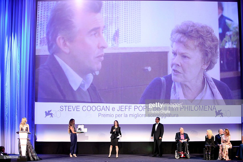 A member of the cast receives the price for Best Screenplay in place of Steve Coogan and Jeff Pope for the film 'Philomena' during the Closing Ceremony during the 70th Venice International Film Festival at the Palazzo del Cinema on September 7, 2013 in Venice, Italy.