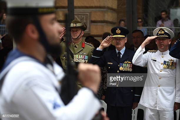 A member of the catafalque party stands at attention as representatives of the Australian Defence Forces salute during the Remembrance Day service at...