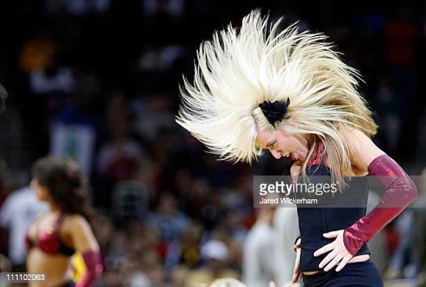 A member of the Cavalier Girls performs during a timeout of the Miami Heat game against the Cleveland Cavaliers on March 29 2011 at Quicken Loans...