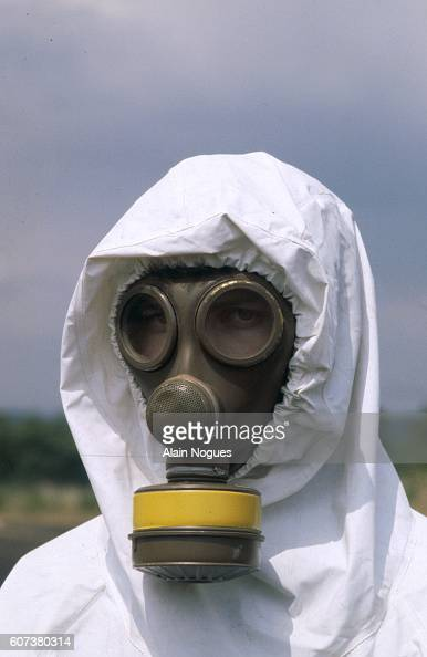 A member of the Cellule Mobile d'Intervention Radiologique unit of French firefighters models his protective chemical suits for treatment of...