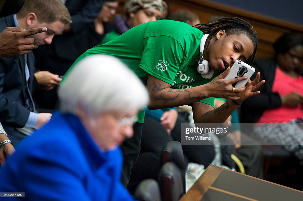 A member of the Center for Popular Democracy takes a picture of Chair of the Federal Reserve Janet Yellen during a House Financial Services committee hearing in Rayburn titled Monetary Policy and the State of the Economy,' February 10, 2016.