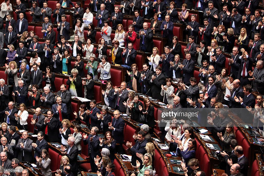 Member of the centre-left coalition claps after Parliament voted for President of Republic on April 20, 2013 in Rome, Italy. After five ballots ended in deadlock the Italian Parliment has re-elected President Giorgio Napolitano for a second term following a last-minute deal between party chiefs.