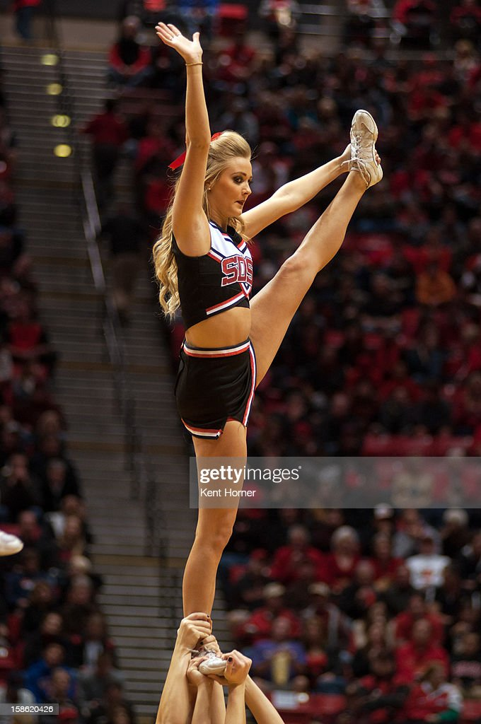 A member of the cheer team for the San Diego State Aztecs performs during a timeout in the first half of the game against the University of San Diego Tereros at Viejas Arena on December 15, 2012 in San Diego, California.