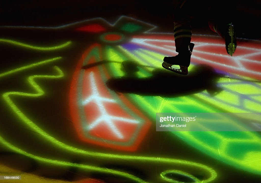 A member of the Chicago Blackhawks skates onto the ice during player introductions before taking on the Minnesota Wild in Game Five of the Western Conference Quarterfinals during the 2013 NHL Stanley Cup Playoffs at the United Center on May 9, 2013 in Chicago, Illinois. The Blackhawks defeated the Wild 5-1 to win the series.