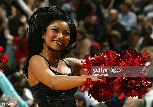 A member of the Chicago Bulls dance team performs for the fans during the game against the San Antonio Spurs on November 7 2005 at the United Center...