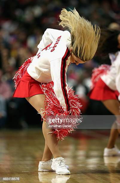 A member of the Chicago Bulls dance team 'The Luvabulls' performs during a break between the Bulls and the Oklahoma City Thunder at the United Center...