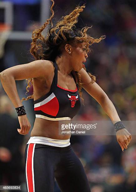 A member of the Chicago Bulls dance team 'The Luvabulls' performs during a break between the Bulls and the Minnesota Timberwolves at the United...