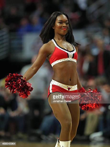 A member of the Chicago Bulls dance team 'The Luvabulls' performs during a break between the Bulls and the Detroit Pistons at the United Center on...