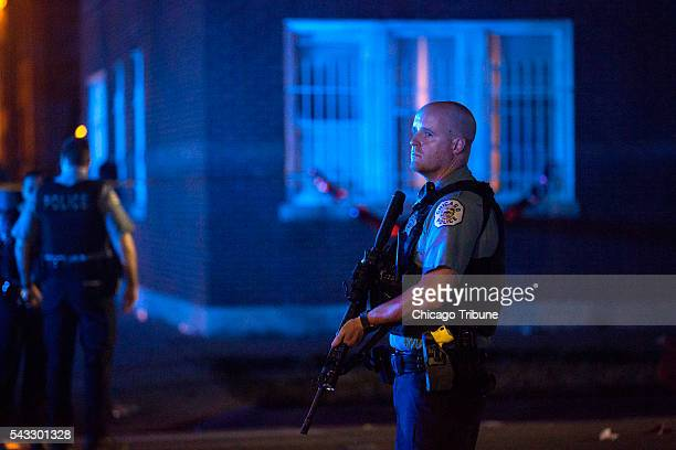 A member of the Chicago Police Department stands at the scene of a fatal shooting in the 700 block of North Ridgeway Avenue Sunday June 26 in the...