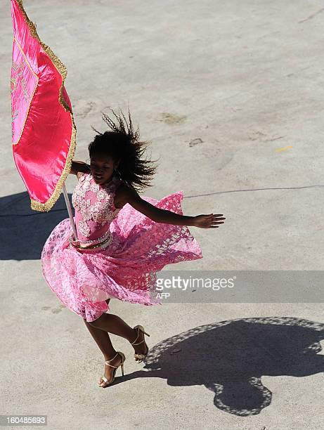 A member of the children's samba school 'Mangueira do Amanha' takes part in a rehersal for the upcoming carnival special group parades at the...