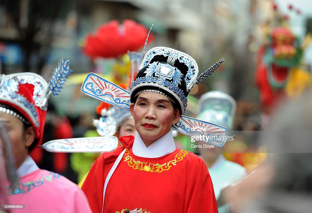A member of the Chinese community in Madrid takes part in the procession to celebrate The Year of The Monkey on February 13, 2016 in Madrid, Spain. The Madrid Town Hall has organised this year's lunar year celebrations for the first time in Madrid's Chinatown district of Usera.