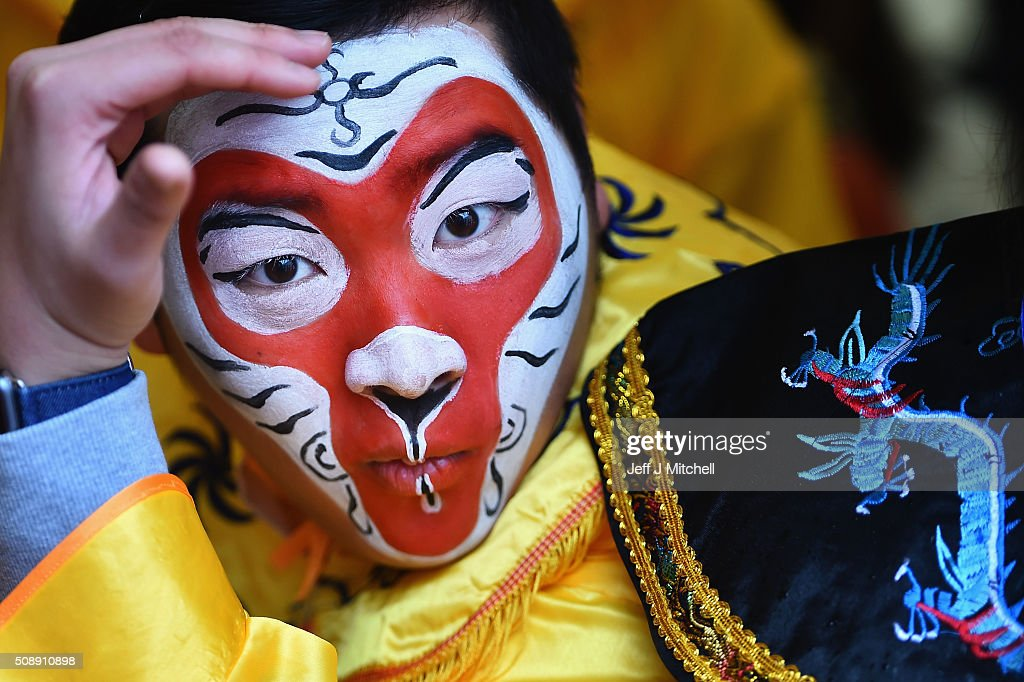 A member of the Chinese community of Glasgow is dressed in traditional costume to celebrate The Year of The Monkey on February 7, 2016 in Glasgow, Scotland. The first ever Chinese New Year celebrations to be held in George Square, The Year of the Monkey begins on February 8th and lasts until January 27, 2017.