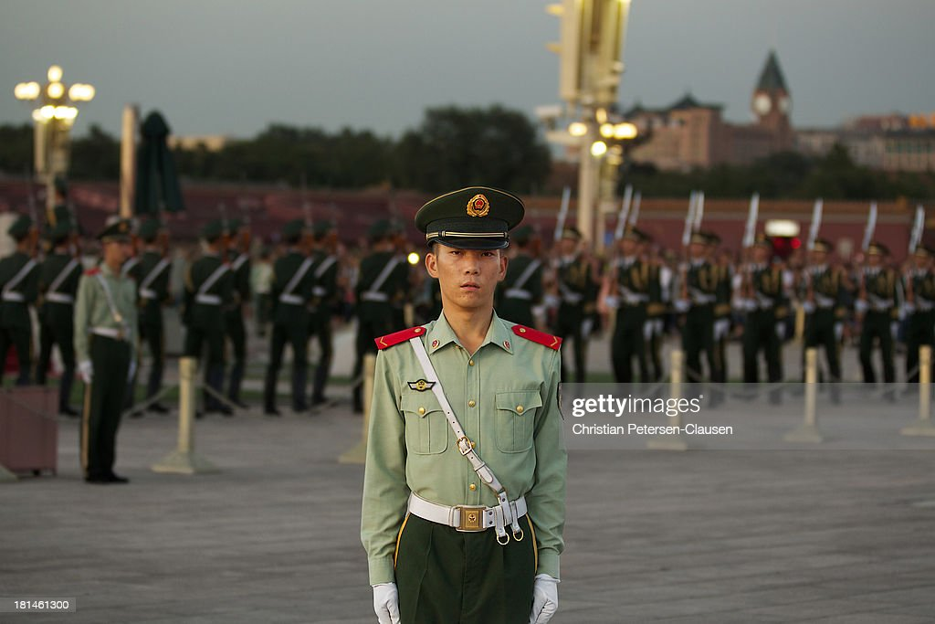 CONTENT] A member of the Chinese People's Armed Police Force stands guard during the daily lowering ceremony for the Chinese national flag at Tiananmen Square, Beijing, China.
