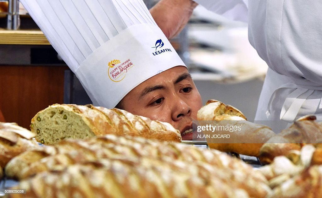 A member of the Chinese team competes in the Bakery World Cup at the 'Europain' fair in Villepinte near Paris on February 7, 2016. / AFP / ALAIN JOCARD
