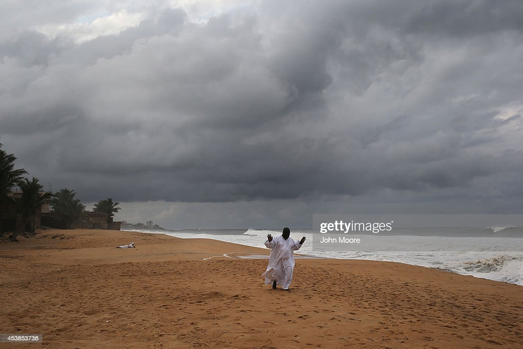 A member of the Church of Aladura prays on the beach on August 20, 2014 in Monrovia, Liberia. He and other church members were praying for God to rescue Liberia from its current crisis. The Ebola virus has killed more than 1,200 people in four African nations, with more in Liberia than any other country.
