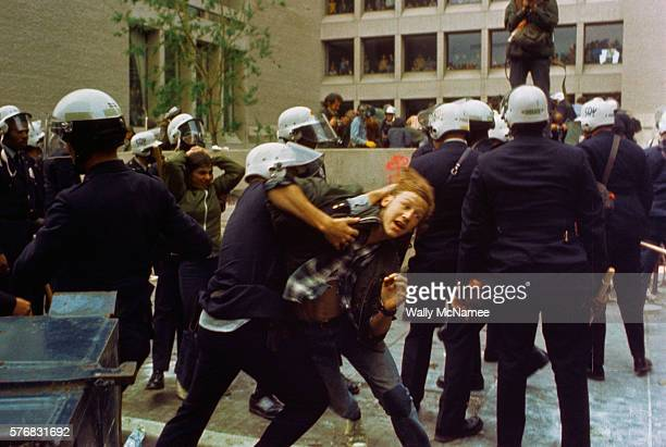 A member of the Civil Disturbance Unit of the Washington Metropolitan police grapples with an unruly student on the George Washington University...