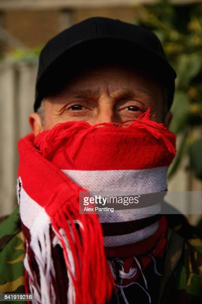 A member of the Clapton Ultras poses for a photo during The Emirates FA Cup Qualifying First Round match between Clapton and Needham Market at The...