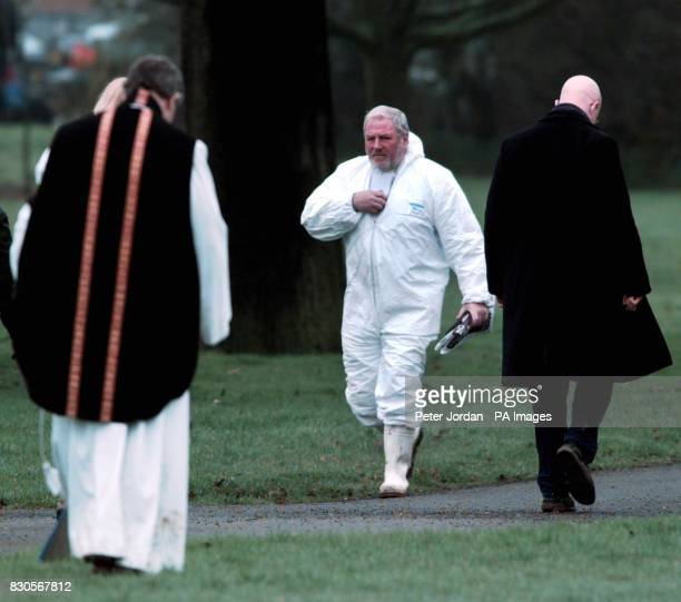 A member of the clergy and others leave the site after the remains of James Hanratty are finally exhumed from the waterlogged grave at Carpenders...
