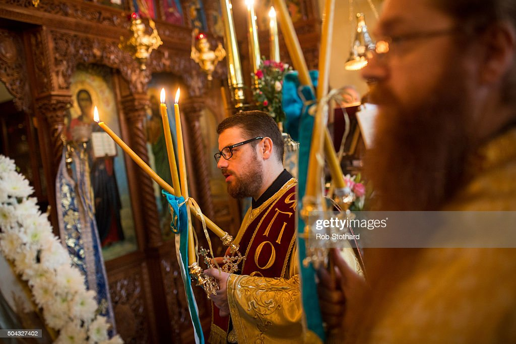 A member of the clergy at the Greek Orthodox Church of St Michael the Archangel attends a service for Feast of the Epiphany lead by His Eminence...