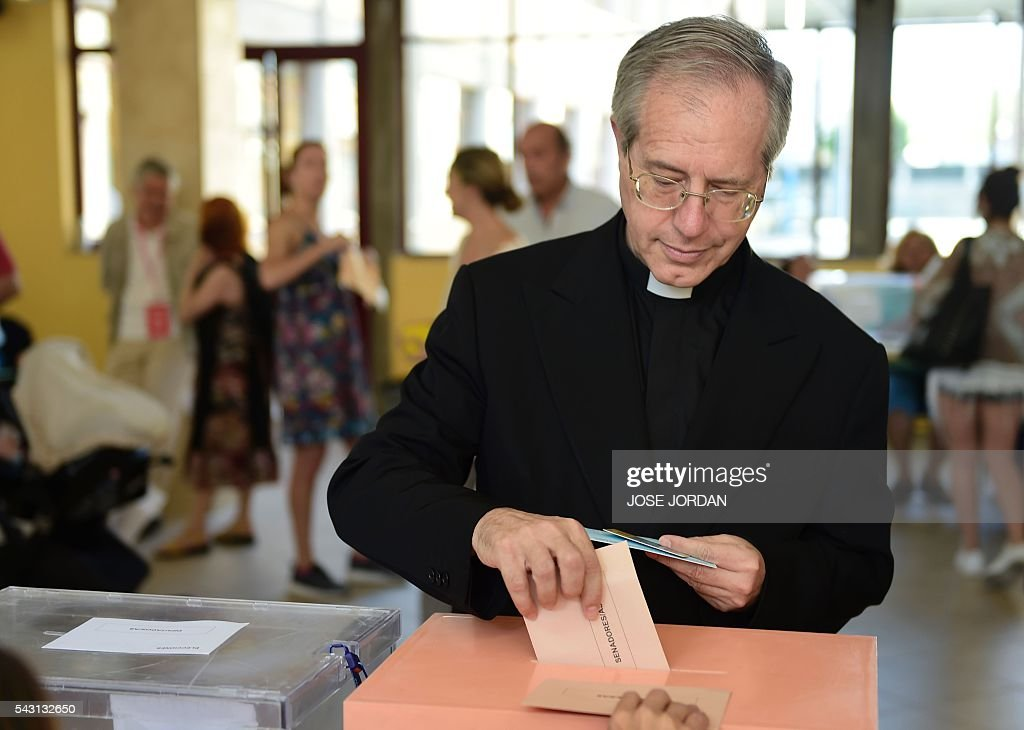 A member of the clergy votes in Spains general election at the Bernadette college polling station in Moncloa-Aravaca, Madrid, on June 26, 2016. Spain votes today, six months after an inconclusive election which saw parties unable to agree on a coalition government. JORDAN