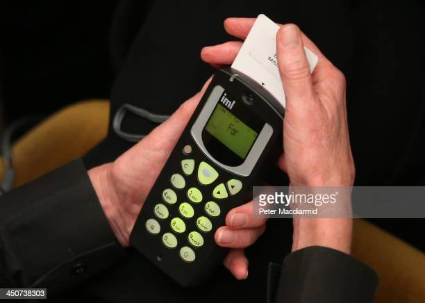 A member of the clergy votes using a hand held terminal during a vote of the ordination of women bishops at the general Synod on November 20 2013 in...