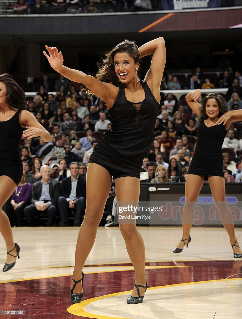A member of the Cleveland Cavaliers dance team entertains fans during a break in the action against the Orlando Magic at The Quicken Loans Arena on February 8, 2013 in Cleveland, Ohio.