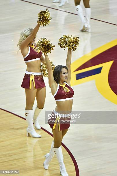 A member of the Cleveland Cavaliers dance team performs for the crowd against the Golden State Warriors at the Quicken Loans Arena During Game Three...