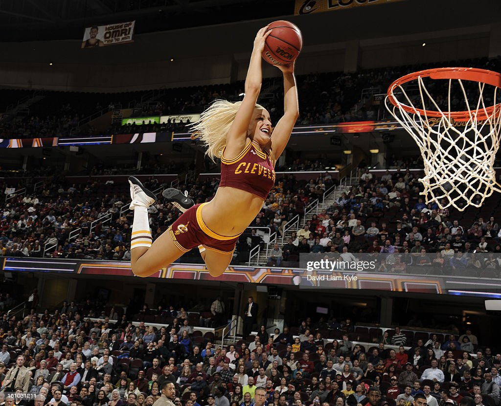 A member of the Cleveland Cavaliers Scream Team flies high for a dunk during a break in the action against the Orlando Magic at The Quicken Loans Arena on February 8, 2013 in Cleveland, Ohio.