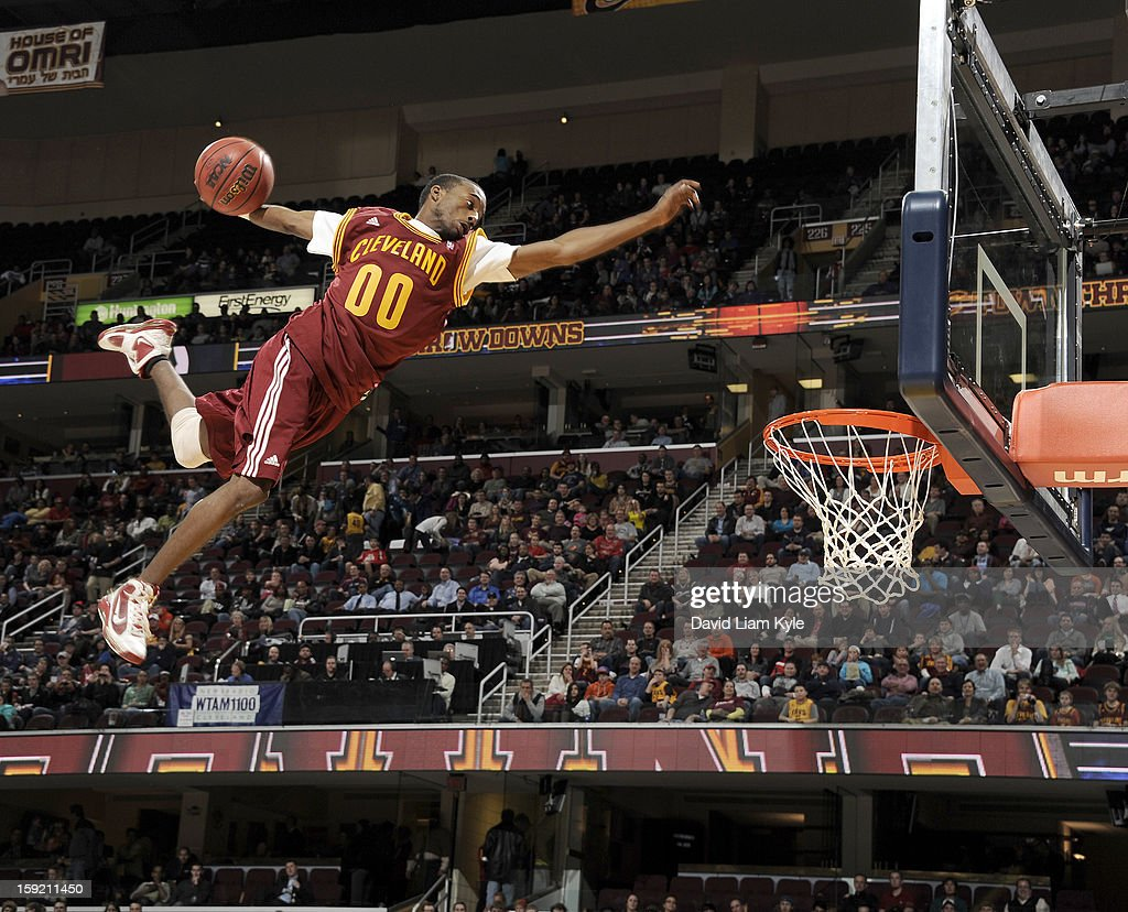 A member of the Cleveland Cavaliers Scream Team flies high off a trampoline for a dunk during a break in the action of the game against the Atlanta Hawks at The Quicken Loans Arena on January 9, 2013 in Cleveland, Ohio.