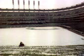 A member of the Cleveland Indians grounds crew plows Jacobs Field 01 April after a spring storm dumped four inches of snow in the Cleveland area...