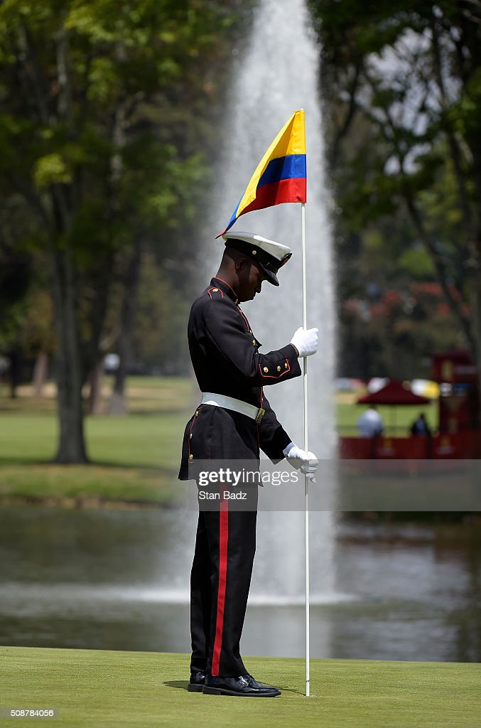 A member of the Colombia military services places a pin flag into the cup on the 18th green during the third round of the Web.com Tour Club Colombia Championship Presented by Claro at Bogotá Country Club on February 6, 2016 in Bogotá, Colombia.