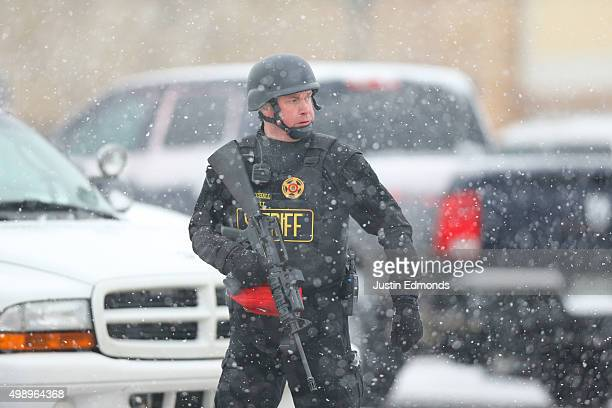 A member of the Colorado Springs sheriff's department secures the scene during an active shooter situation near a Planned Parenthood facility where...