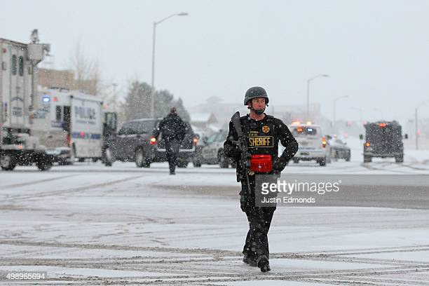 A member of the Colorado Springs sheriff's department secures the scene during an active shooter situation outside a Planned Parenthood facility...